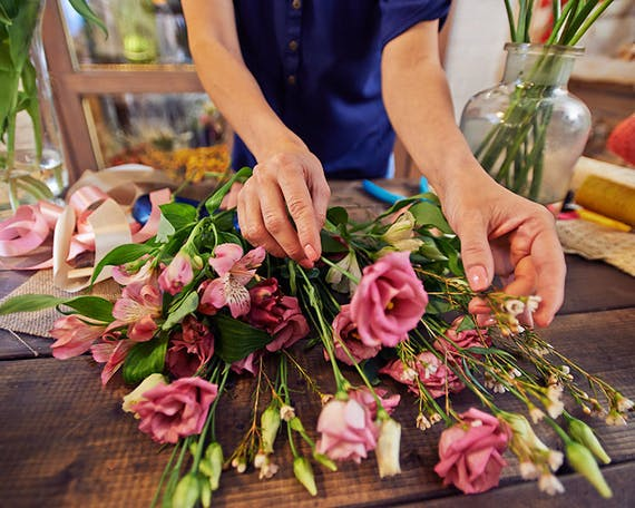 The skilled hands of a local floral designer ply their trade